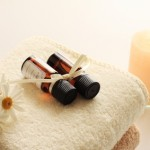 Aroma oil and candle with towel
