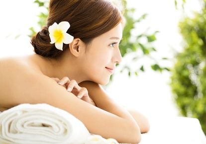 Beautiful young woman enjoy spa salon